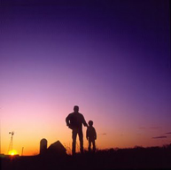silhouette farmer and son
